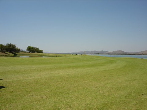 Halfway down the 9th fairway on the dog leg with the lakes both left and right